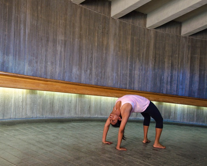conceptual photography - women practice relaxing yoga in the train station