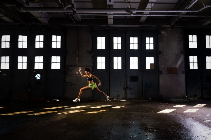 athlete jumping in abandoned warehouse