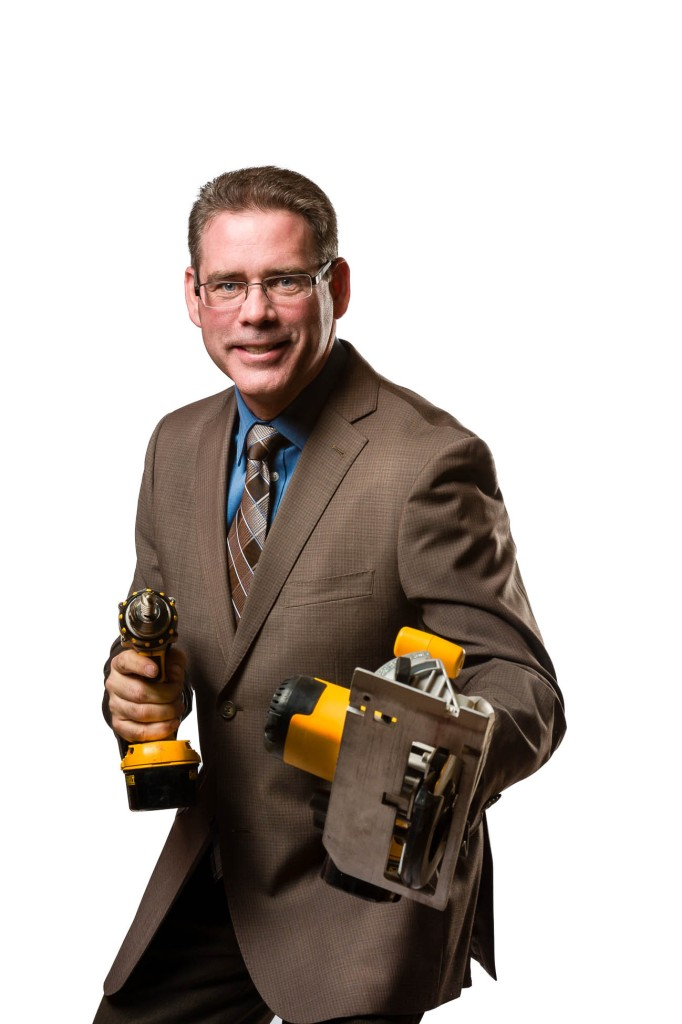 portraits headshots of business man with circular saw and drill