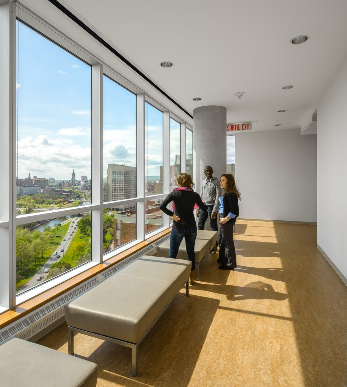 Students enjoying the view from the top overlooking the Rideau Canal & Parliament Hill - University of Ottawa Faculty of Sciences by Diamond Schmitt Architects