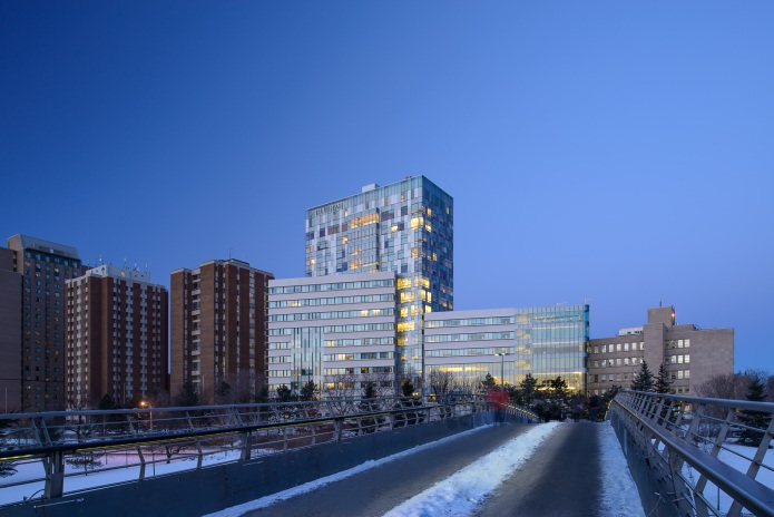 University of Ottawa Faculty of Sciences Building from the Rideau Canal in winter at dusk
