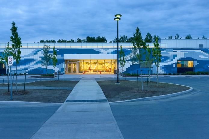 Francois Dupuis Recreation Centre exterior at dusk - Orleans by GRC Architects