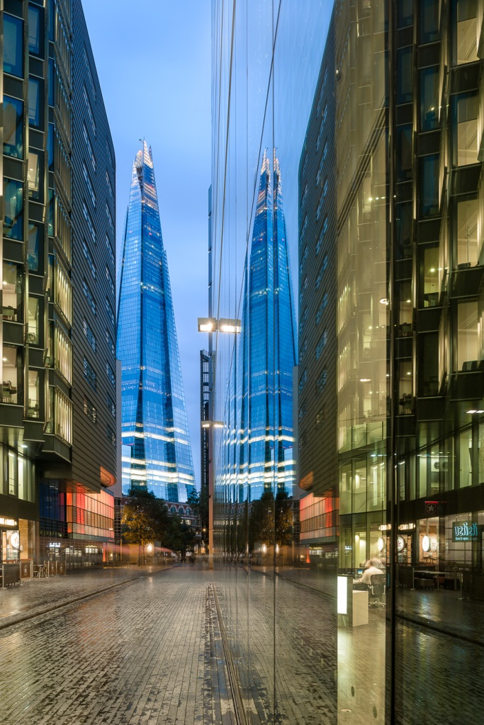 London's The Shard by Renzo Piano at dusk - reflection in building