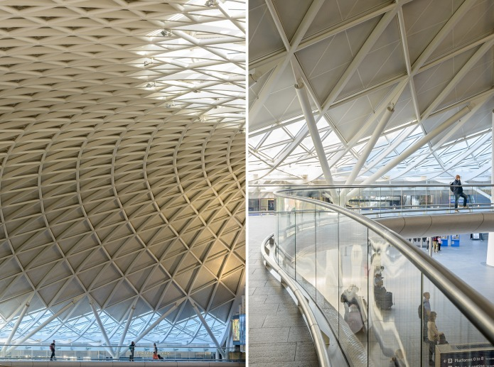 Travelers crossing the suspended walkway at London's King's Cross Train Station by McAslan and Partners