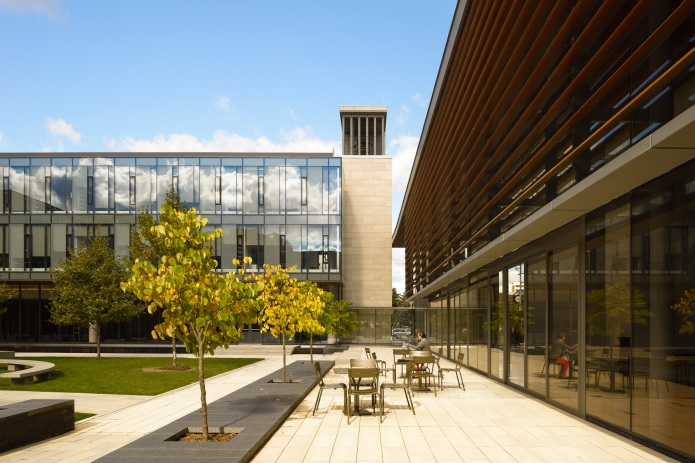 Enjoying the sun in the  courtyard at the Centre for International Governance Campus in Waterloo - KPMB Architects