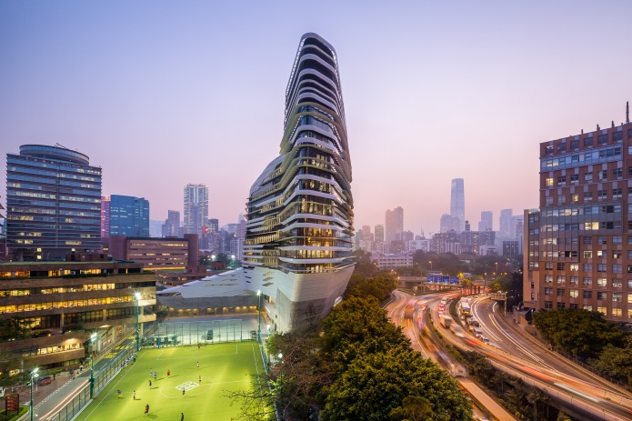 Dusk view of the HK Innovation Tower by Zaha Hadid Architects