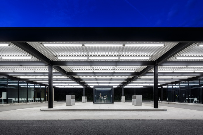 Converted Mies van der Rohe gas station after dusk