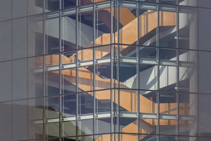 Exterior closeup of the central staircase at the Anne-Marie Edward Science Building through the glazing