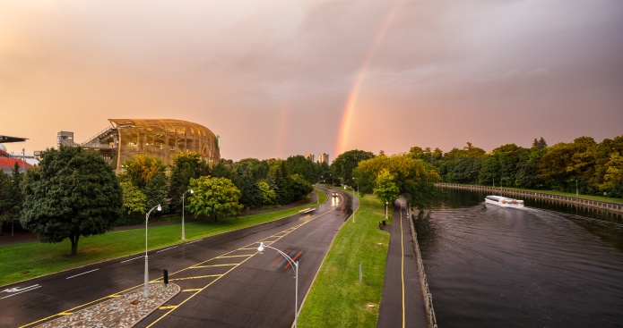 Panoramic view of lansdowne stadium and Rideau Canal with rainbows and thunderstorm in the background