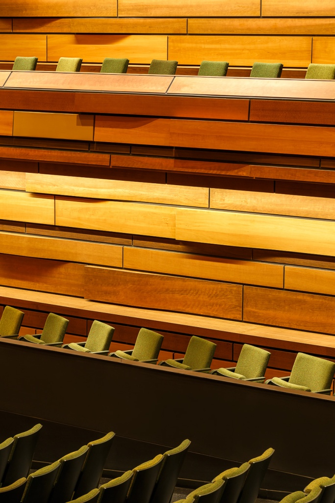 Detail of the seats and wood paneling at the performance hall at the Isabel Bader Centre